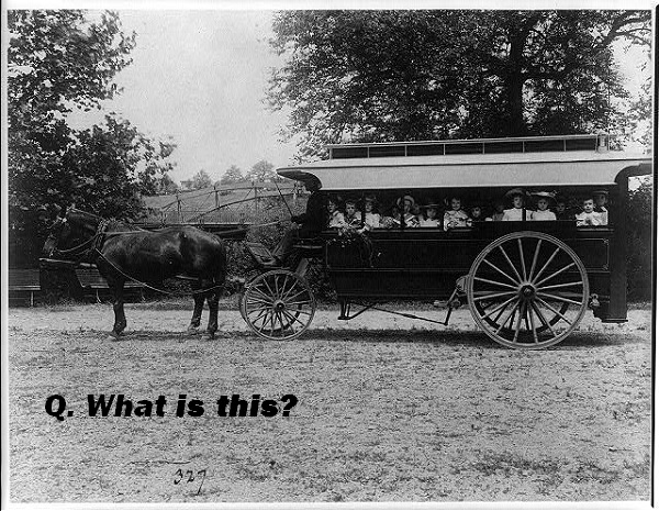 Where are these kids going in this horse-drawn vehicle?