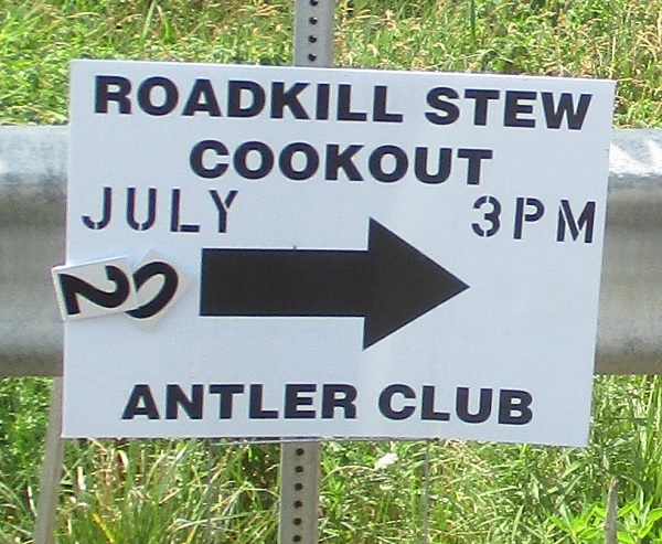 A sign for Roadkill Stew