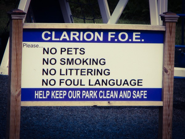 Sign in a park warning about 'No foul language'.