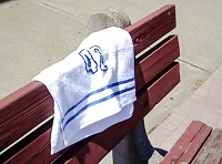 Towel resting on a park bench.
