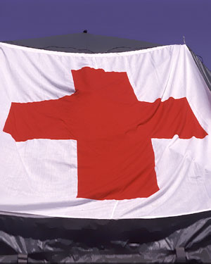 Red cross flag on a tent