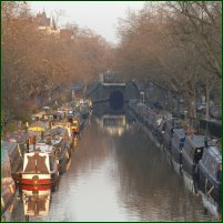 Barges and canal boats moored up in Little Venice on the Regent's Canal in Maida Vale, during winter.