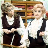 Miss Brahms (Wendy Richard) and Mrs Slocombe (Mollie Sugden) providing customer service for Grace Brothers.