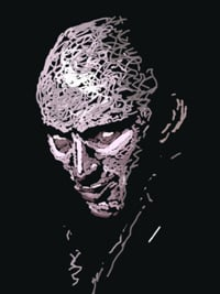 Richard O'Brien, his face half-hidden in shadow.