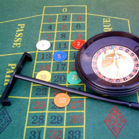 A roulette table and wheel.
