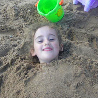 Buried in the sand.
