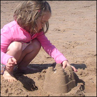 Building a sandcastle.