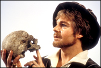 Hamlet beholds the skull of Yorrick - a scene that might have been a bit cheerier with a few nice songs.