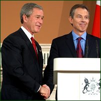 George Bush and Tony Blair shake hands.