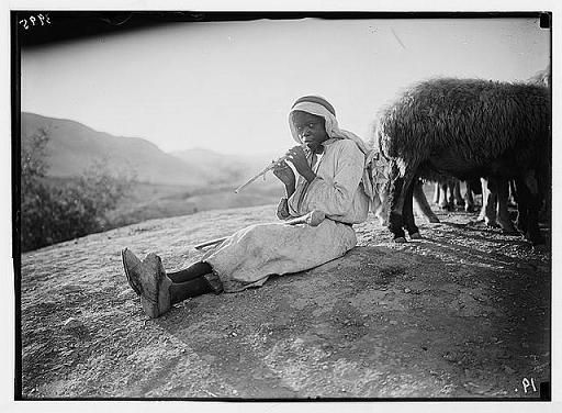 A shepherd piping in the Jordan Valley.