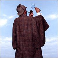 An actor portraying well-known cloak-wearer Sherlock Holmes.