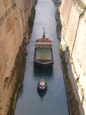 A ship is brought through the Corinth Canal, Greece.