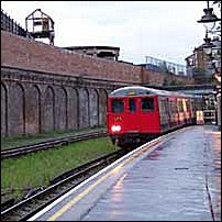 An underground train approaching Shoreditch station on the East London Line.
