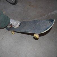 A foot tilting a skateboard.