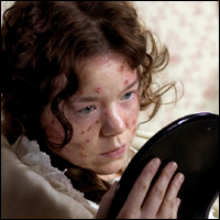 Esther from Charles Dickens's 'Bleak House' falls sick with smallpox and examines the tell-tale spots on her face.