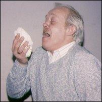 A man sneezing.
