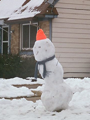 A snowman wearing a rather fetching hat