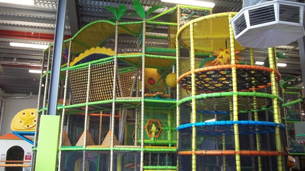 A photo of climbing equipment inside a soft play centre.