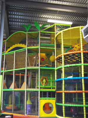 A photo of climbing equipment inside a soft play centre.