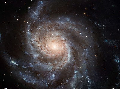 An image of the gigantic Pinwheel galaxy, the largest and most detailed photo of a spiral galaxy ever taken with Hubble.