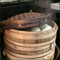 Dim sum being cooked in a steamer.