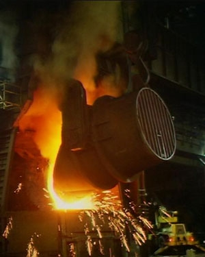 Iron is poured into a steelmaking furnace