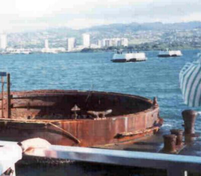The turrets of The USS Arizona still visible below the Memorial