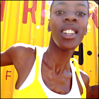 A South African girl in a yellow T-shirt, in a picture taken from BBC Sport's World Cup 2010 coverage.