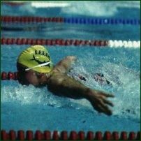 A swimmer demonstrating butterfly stroke.
