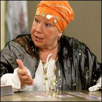 EastEnders's Mo (Laila Morse) tries tarot.