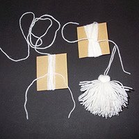 The process of making a tassel, in action.