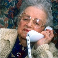 A lady answering the telephone.
