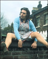 Terry Jones, dressed as an old lady sitting on a wall. We daren't tell you what the name of the character is.
