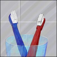 Two toothbrushes in a glass.