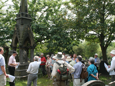 A group of visitors listen to a tour guide.