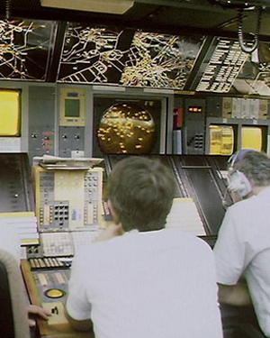 Men at work inside an air traffic control office