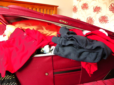 An overfilled suitcase.