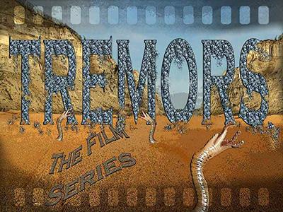 Tremors illustration with desert scene and worm-like graboid