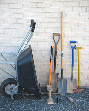 A selection of tools for digging a trench.