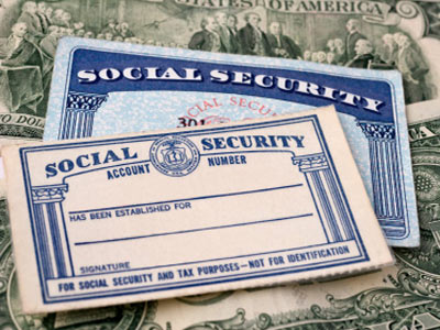 Two US Social Security cards with some money.