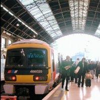 Passengers disembark at Victoria Station.