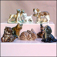Small, glazed figurines of puppies, kittens and a rabbit.