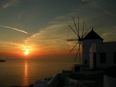 A Greek windmill at sunset, Oia, Santorini, Greece.