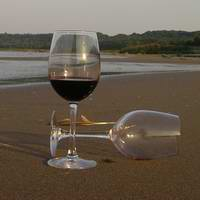 Two glasses of wine on a beach