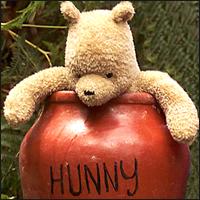 Winnie the Pooh in a terracotta 'hunny' pot.