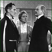 Shot from 1958 BBC Production of 'The Winslow Boy' with Peter Cushing as Sir Robert Morton, Nora Swinburne as Grace Winslow and John Robinson as Arthur Winslow.
