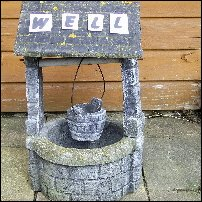 The word 'well' on a well.