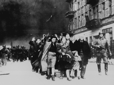 Jewish civilians rounded up by German soldiers during the destruction of the Warsaw Ghetto, 1943